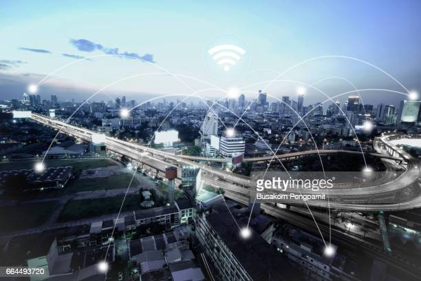 City scape and network connection concept, illuminated by light of cities, surrounded by a luminous network, city network technology