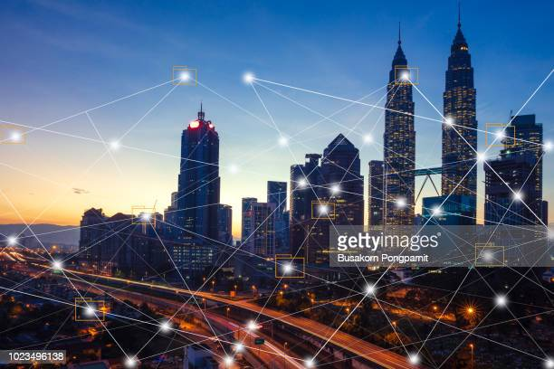 city scape and network connection concept.digital skyscrappers with wire texture. technology and connection concept. - building icon stock photos and pictures