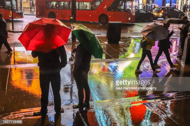city scene at night in rain - colour image stock pictures, royalty-free photos & images
