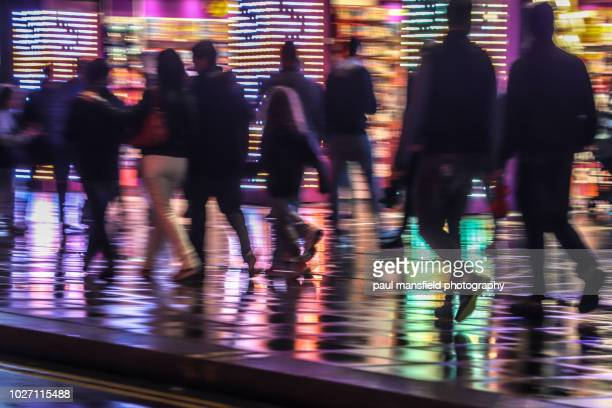 city scene at night in rain - consumerism stock pictures, royalty-free photos & images