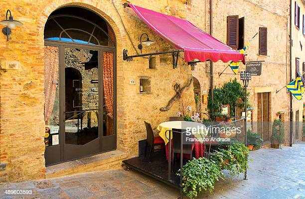 City scene with charming restaurant Volterra, Italy.