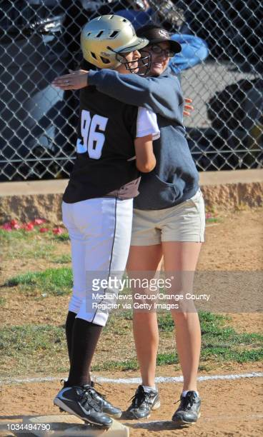 SAN PEDRO LA City Section CIF softball semifinal San Pedro lost to Kennedy 31 8th inning Kennedy's Adrianna Correa gets a hug for her first base...