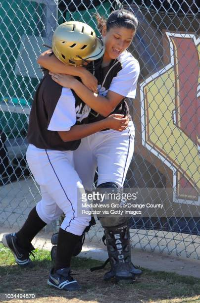 SAN PEDRO LA City Section CIF softball semifinal San Pedro lost to Kennedy 31 Kennedy's Danielle Estrada left gets a bear hug from teammate Adrianna...