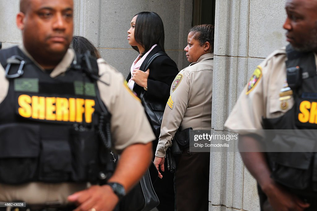 City Sheriff's deputies form a perimeter around State's Attorney for Baltimore Marilyn Mosby (C) as she leaves the Baltimore City Circuit Courthouse East where pre-trial hearings were held for six police officers charged in the death of Freddie Gray September 2, 2015 in Baltimore, Maryland. Earlier this year Gray, 25, suffered a severe spinal cord injury while in police custody and later died. His funeral was followed by rioting, looting and arson.