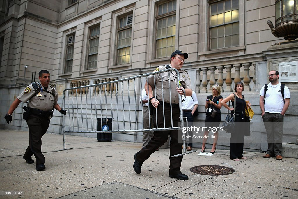 City Sheriff's deputies place barricades in front of the Baltimore City Circuit Courthouse East where pre-trial hearings will be held for six police officers charged in the death of Freddie Gray September 2, 2015 in Baltimore, Maryland. Earlier this year Gray, 25, suffered a severe spinal cord injury while in police custody and later died. His funeral was followed by rioting, looting and arson.