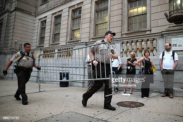 City Sheriff's deputies place barricades in front of the Baltimore City Circuit Courthouse East where pretrial hearings will be held for six police...