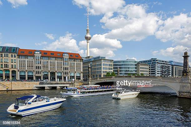 City sightseeing - Berlin skyline with many tourist boat and TV-Tower near Spree river