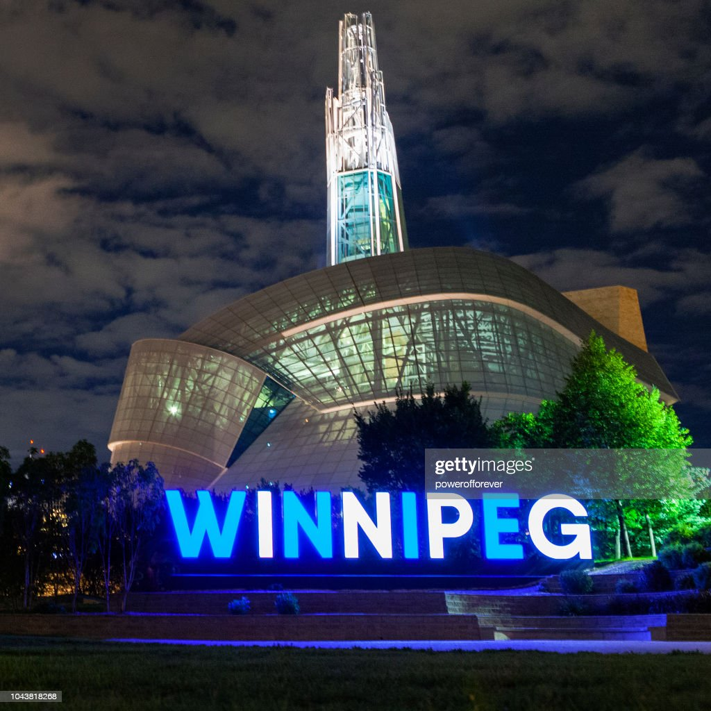 City Sign and Canadian Museum of Human Rights Illuminated at Night in Winnipeg, Canada : Stock Photo
