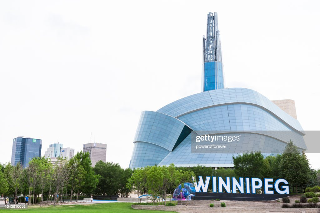 City Sign And Canadian Museum Of Human Rights In Winnipeg