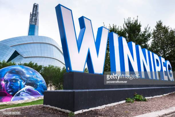 city sign and canadian museum of human rights in winnipeg, manitoba, canada - human rights stock pictures, royalty-free photos & images