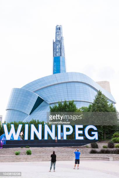 City Sign and Canadian Museum of Human Rights in Winnipeg, Manitoba, Canada