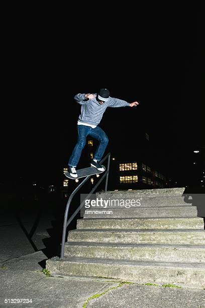 City Skateboarder Skating A Stair Set and Handrail