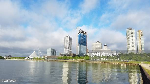 City Skyline Against Cloudy Sky