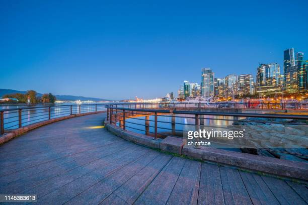 city skyline and marina of vancouver from stanley park - vancouver stock pictures, royalty-free photos & images
