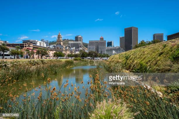 city skyline and moat at castle of good hope, cape town, western cape, south africa - moat stock pictures, royalty-free photos & images