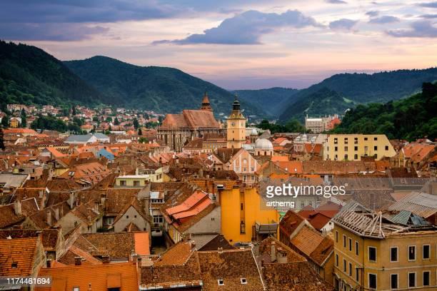 city skyline and tampa mountains, brasov, transylvania, romania - romania stock pictures, royalty-free photos & images