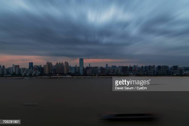 city skyline at dusk - wuhan stock photos and pictures