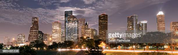 a city skyline at night in houston, texas. - houston skyline stock pictures, royalty-free photos & images
