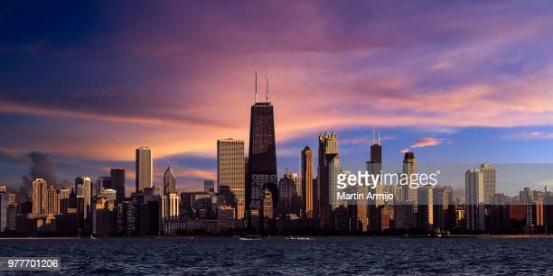 city skyline at sunset, chicago, illinois, usa - hancock building chicago stock photos and pictures