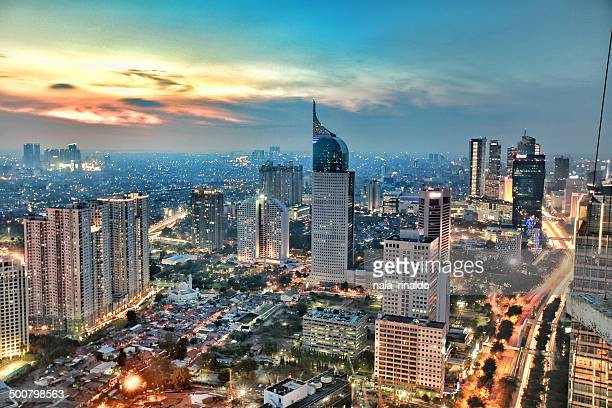 city skyline at sunset, jakarta, indonesia - indonesien stock-fotos und bilder