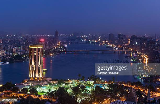 city skyline - cairo at dusk - cairo stock pictures, royalty-free photos & images