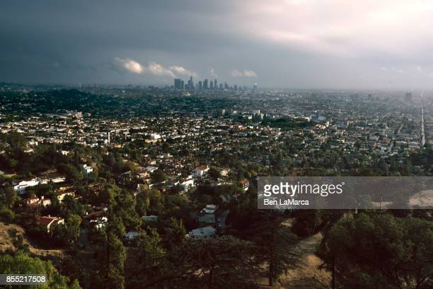 la city skyline griffith storm - hollywood hills stock pictures, royalty-free photos & images