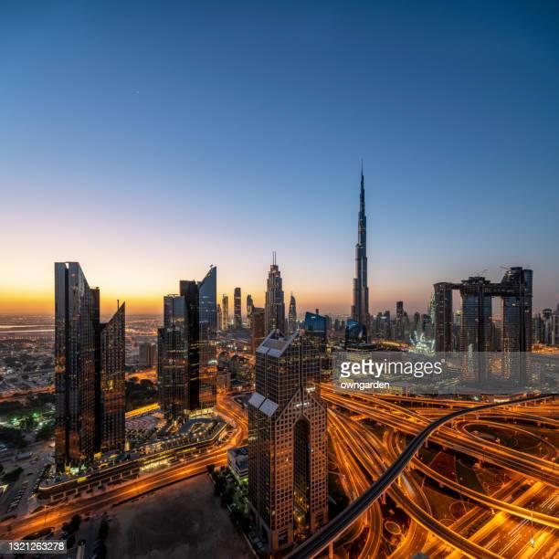 city skyline in dubai at sunrise - united arab emirates stock pictures, royalty-free photos & images