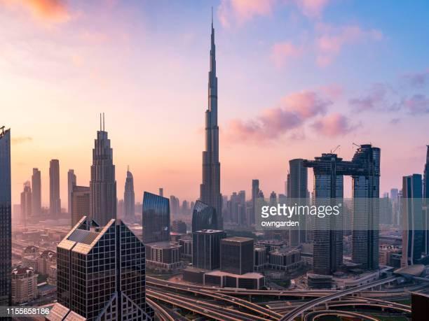 city skyline in dubai - burj khalifa stock pictures, royalty-free photos & images