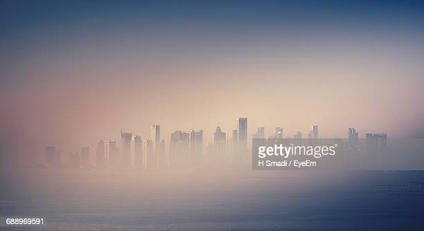 city skyline in foggy weather - qatar stock pictures, royalty-free photos & images
