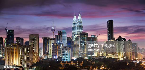 city skyline - kuala lumpur at dusk panoramic view - malaysia stock pictures, royalty-free photos & images