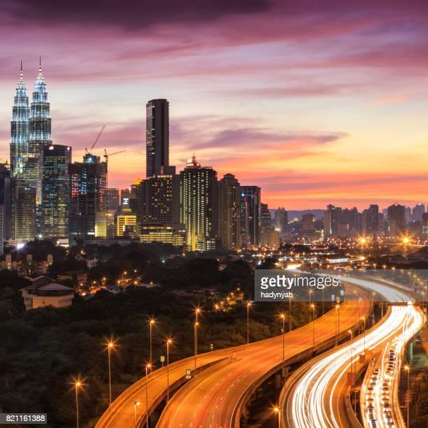 city skyline - kuala lumpur at dusk - menara kuala lumpur tower stock photos and pictures