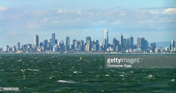CONTENT] City skyline of Melbourne while departing on a cruise ship with choppy seas on Port Phillip Bay Victoria Australia