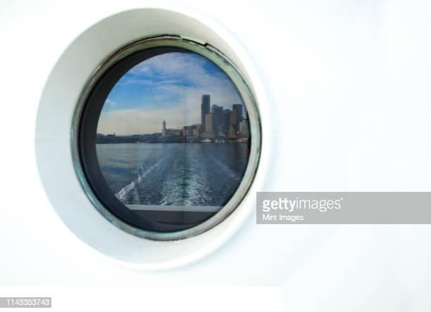 city skyline reflected in ferry porthole, seattle, washington, united states - 遠洋定期船 ストックフォトと画像