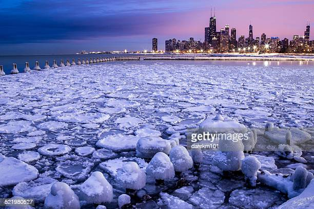 city skyline seen across icy harbor, chicago, illinois, america, usa - north avenue beach stock pictures, royalty-free photos & images
