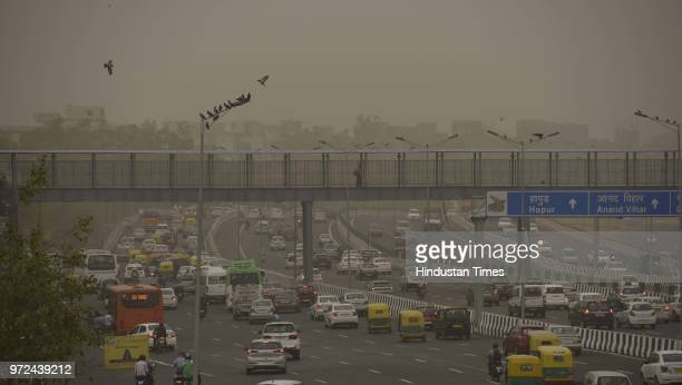 City skyline seen engulfed with thick dust particles at Akshardham flyover on June 12 2018 in New Delhi India Dust pollution in New Delhi has been...