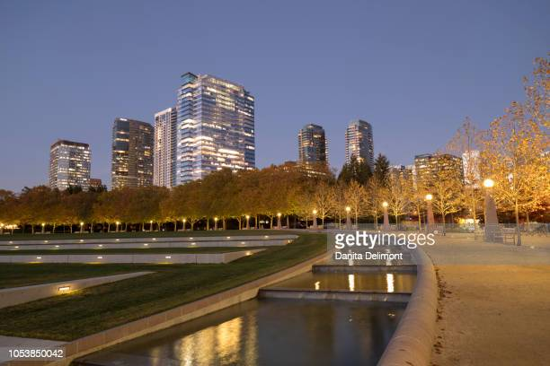 city skyline seen from downtown park, bellevue, king county, washington state, usa - bellevue washington state stock photos and pictures
