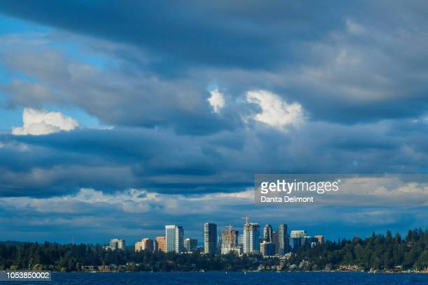 city skyline seen from lake washington, bellevue, king county, washington state, usa - bellevue skyline stock pictures, royalty-free photos & images