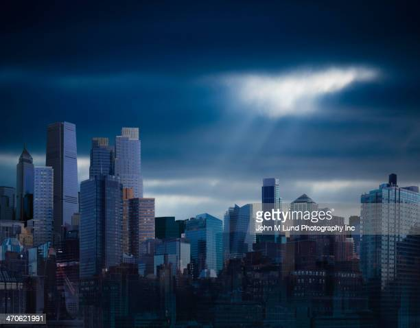 City skyline under stormy sky