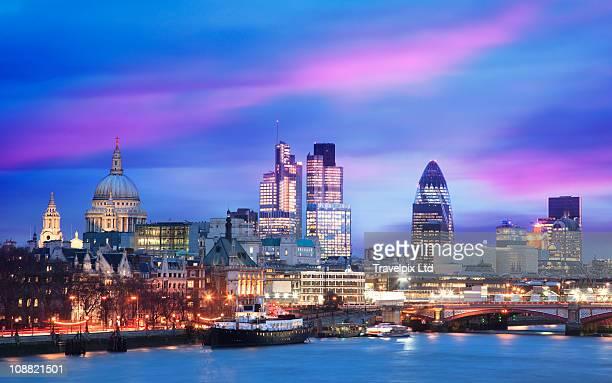City Skyline viewed over river Thames at dusk