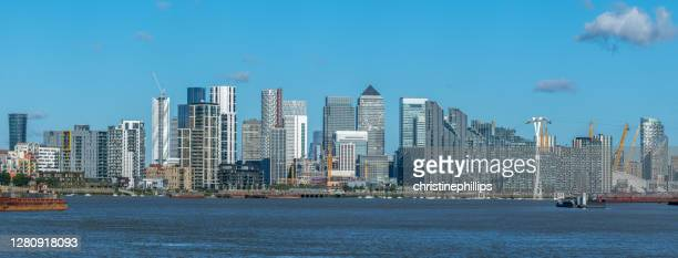 city skyline with canary wharf, millennium dome and cable car across river thames, london, england, uk - the o2 england stock pictures, royalty-free photos & images