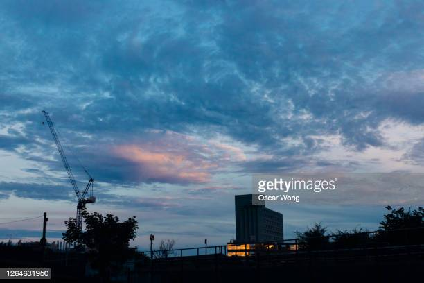 city skyline with industrial crane against the sky at dawn - morning stock pictures, royalty-free photos & images