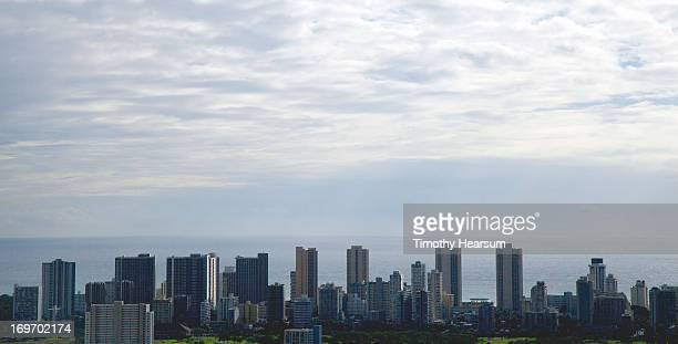 city skyline with ocean and clouds beyond - timothy hearsum stock photos and pictures
