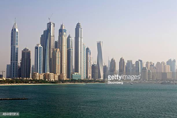 City skyscrapers stand on the waterfront seen from a construction site of residential apartments operated by Skai Holdings LLC on Palm Jumeirah...