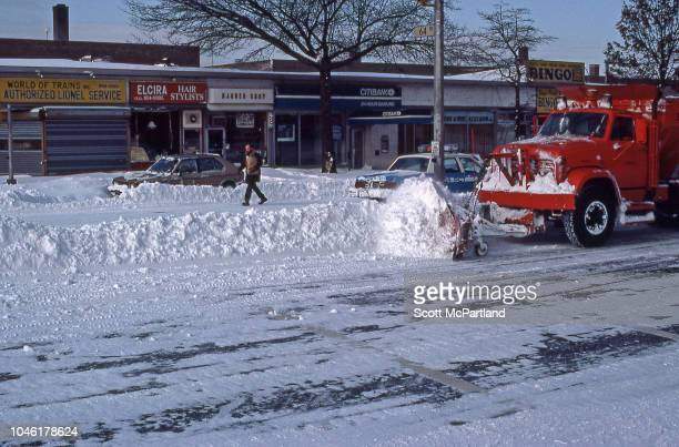 A city snowplow clears Woodhaven Blvd in the aftermath of a blizzard Queens New York New York February 13 1983
