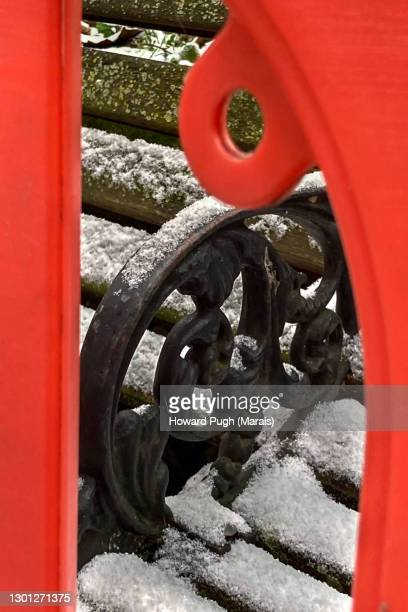 city snowscapes. snow covered bench and red plastic road sign - howard pugh stock pictures, royalty-free photos & images