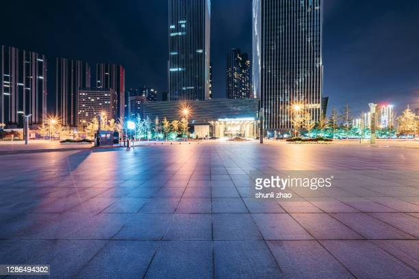 city square at night - courtyard stock pictures, royalty-free photos & images