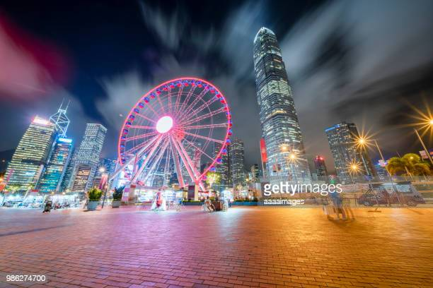 city square with illuminated big wheel in central hong kong - two international finance center stock pictures, royalty-free photos & images