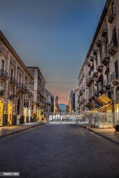 city street against clear sky - catania stock photos and pictures
