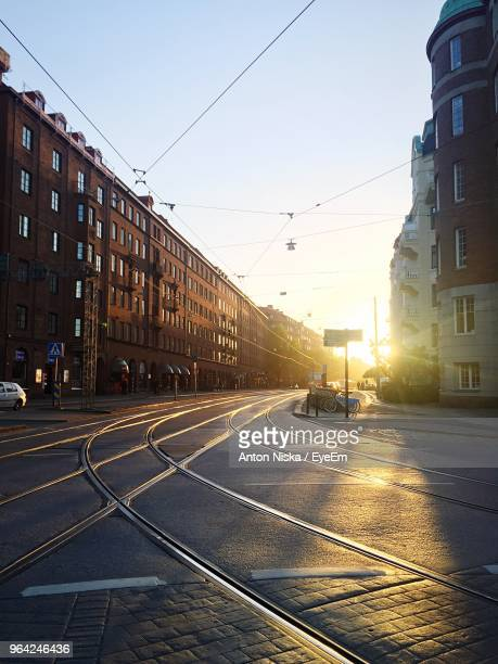 city street amidst buildings during sunset - gothenburg stock pictures, royalty-free photos & images