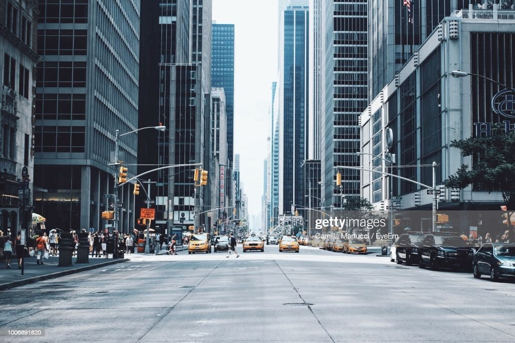 City Street Amidst Buildings : Stock Photo